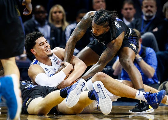 Memphis forward Isaiah Maurice (left) battles South Dakota State guard David Jenkins (right) for a loose ball during action at the FedExFourm., Tuesday, December 4, 2018.