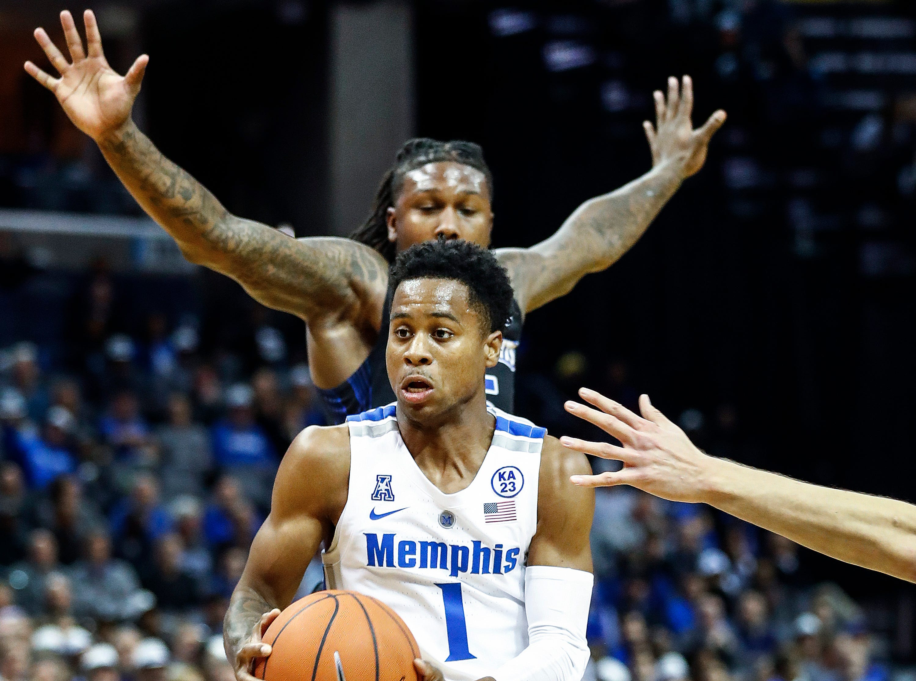 Memphis guard Tyler Harris drives the lane against the South Dakota State defense during action at the FedExFourm., Tuesday, December 4, 2018.