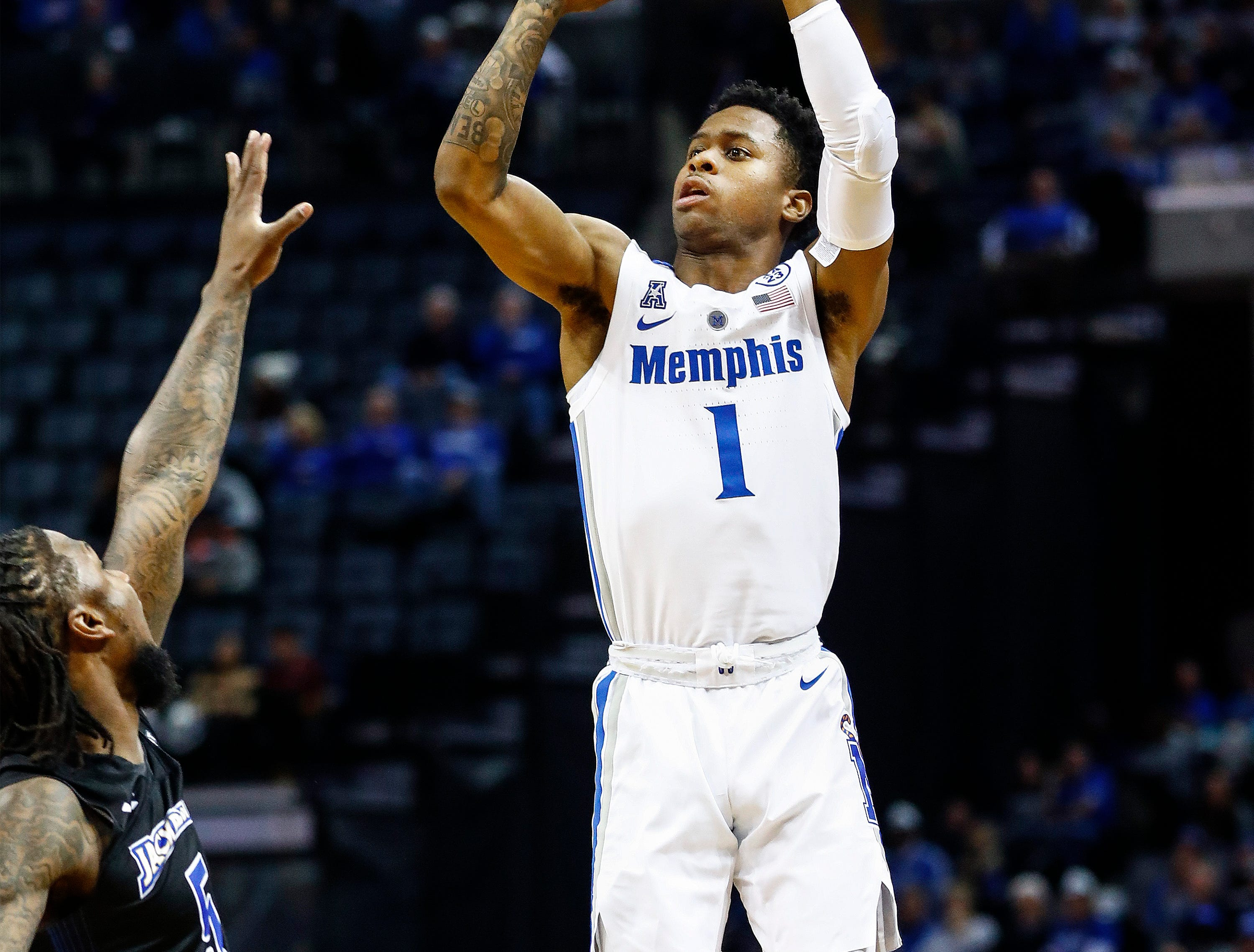 Memphis guard Tyler Harris hits a 3-pointer against the South Dakota State defense during action at the FedExFourm., Tuesday, December 4, 2018.