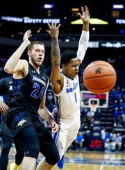 Memphis guard Tyler Harris (right) loses the ball out of bounds while guarded by South Dakota State defender Mike Daum (left) during action at the FedExFourm., Tuesday, December 4, 2018.