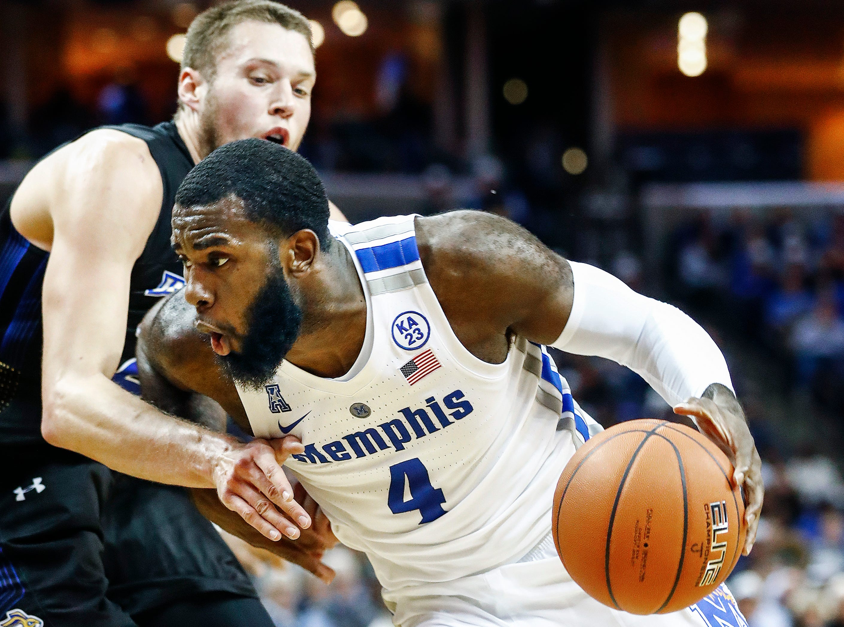 Memphis forward Raynere Thornton (right) drives the lane against South Dakota State defender Mike Daum (left) during action at the FedExFourm., Tuesday, December 4, 2018.