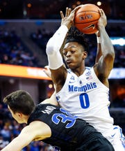 Memphis forward Kyvon Davenport (top) is called for a foul while battling South Dakota State Alex Arians (bottom) for a rebound during action at the FedExFourm., Tuesday, December 4, 2018.