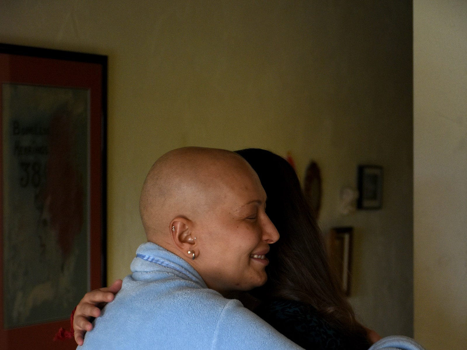 Laura Gunga gets a hug from friend and supporter Nora Halimi. Marco Island resident Laura Gunga is leaning on the help of her friends as she copes with breast cancer.
