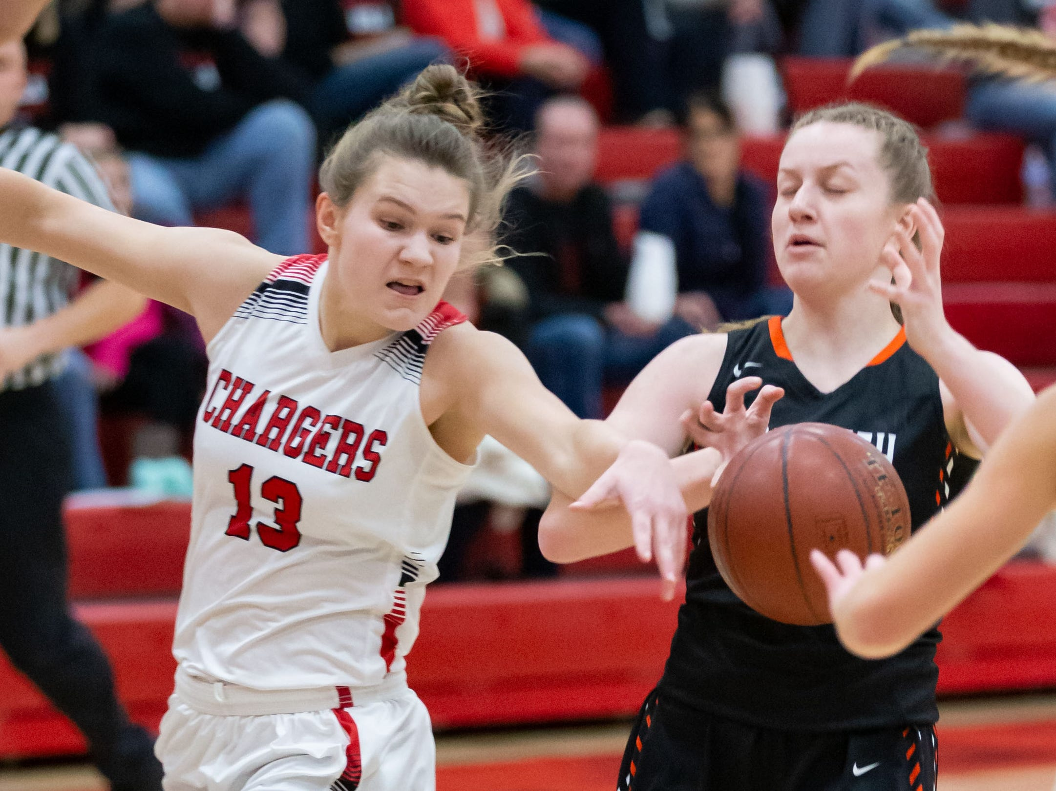 Hamilton senior Elizabeth Behrndt (13) swats the ball away from Plymouth's Alesha Kaat-Fohr (4) during the game at Hamilton on Tuesday, Dec. 4, 2018.
