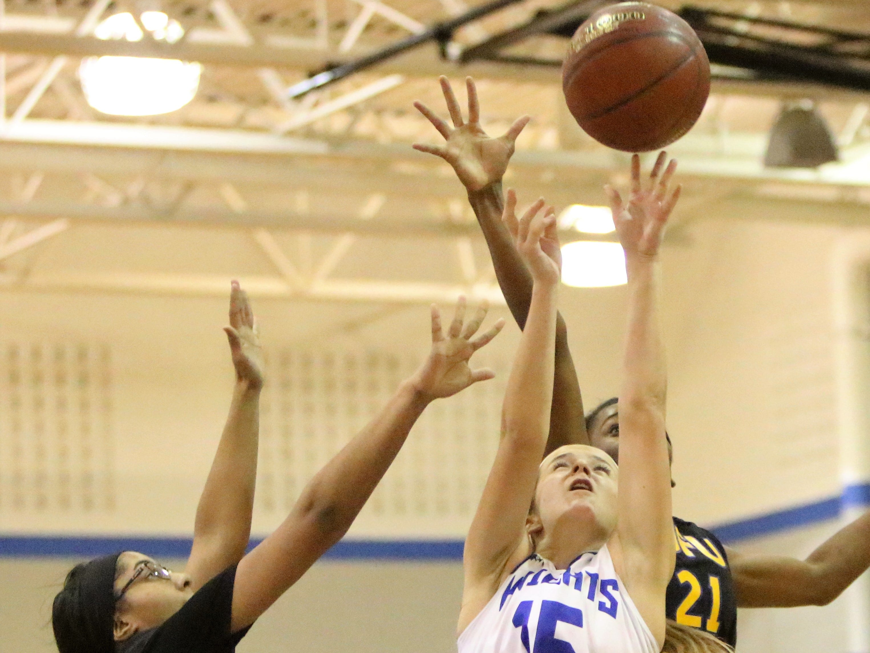 Oak Creek guard Jenna Blunt goes up for a shot over a pair of Milwaukee King defenders on Dec. 4.