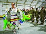 Army Pfc. Loretta Menchaca of Keshena, a member of the Menominee nation, danced at a pow wow in Kuwait with other Native American soldiers.