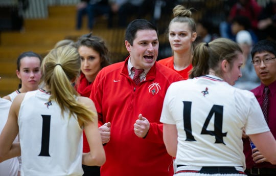 """Waukesha South girls basketball head coach Erik Loose fires up his team during a game in 2018. After a shooting at the school on Monday, Loose said """"it was good for the kids to be able to get out there and play"""" in Tuesday's conference opener against Catholic Memorial."""