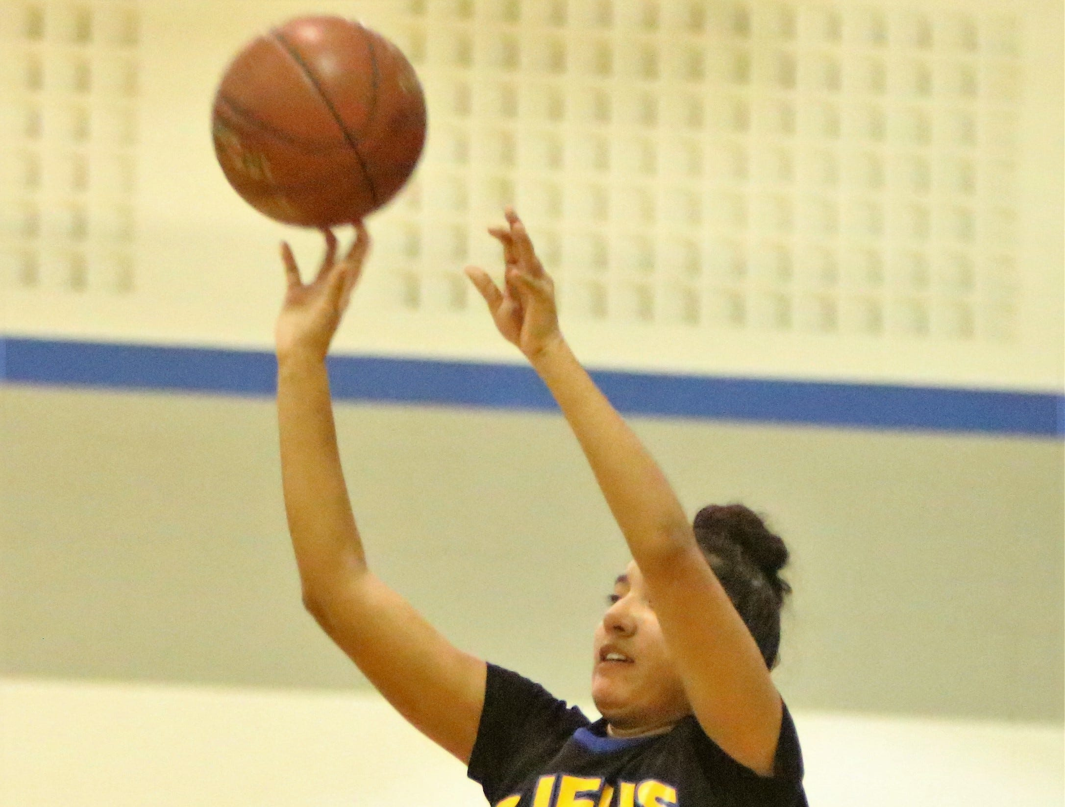 Milwaukee King guard Annaly Garcia puts up a three-point shot against Oak Creek on December 4.