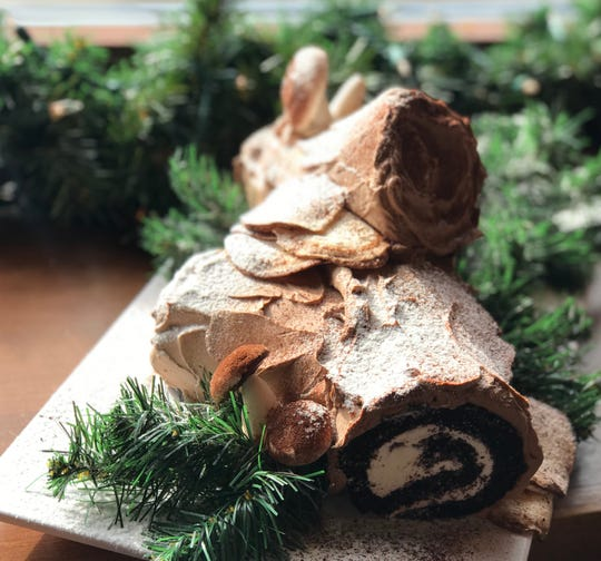 A more traditional buche de noel, decorated to look like logs and accompanied by meringue mushrooms, is made at Rocket Baby Bakery, 6822 W. North Ave., Wauwatosa.