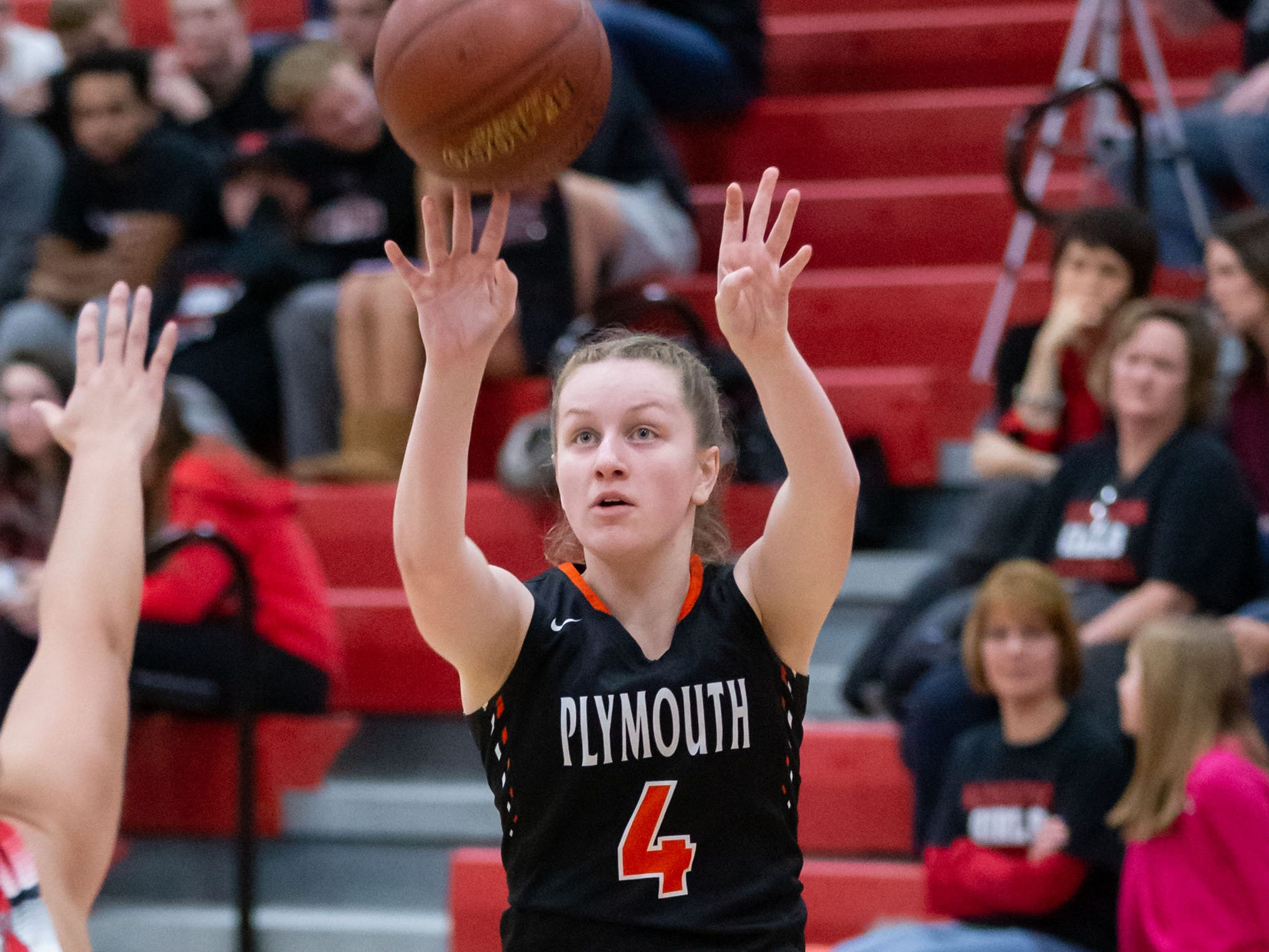 Plymouth junior Alesha Kaat-Fohr (4) elevates for three during the game at Hamilton on Tuesday, Dec. 4, 2018.