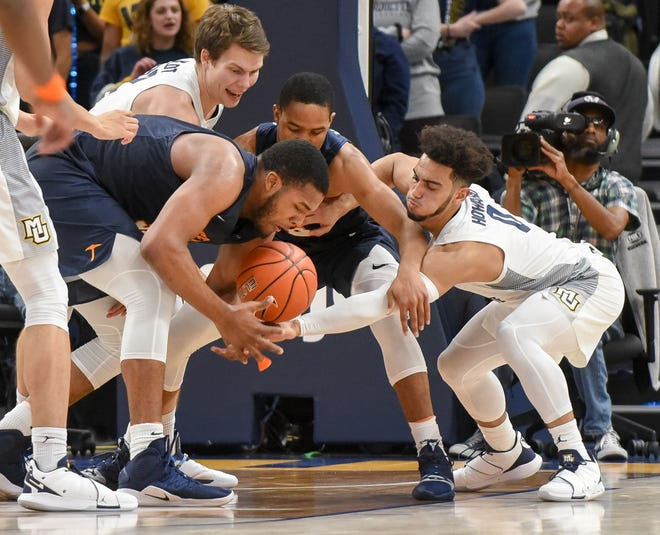 UTEP forward Efe Odigie (second from left) and guard Nigel Hawkins battle with Marquette center Matt Heldt (top) and guard Markus Howard for a loose ball.