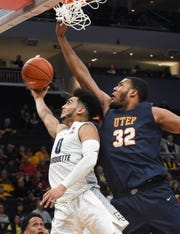 Marquette guard Markus Howard puts up a reverse layup under UTEP forward Efe Odigie.