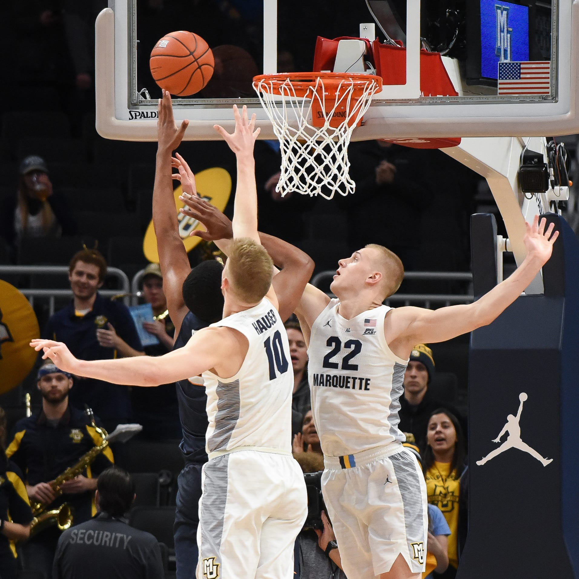 Marquette's Hauser brothers and UW's Trevor Anderson are lifelong friends. Now they are on opposite sides of a heated rivalry.