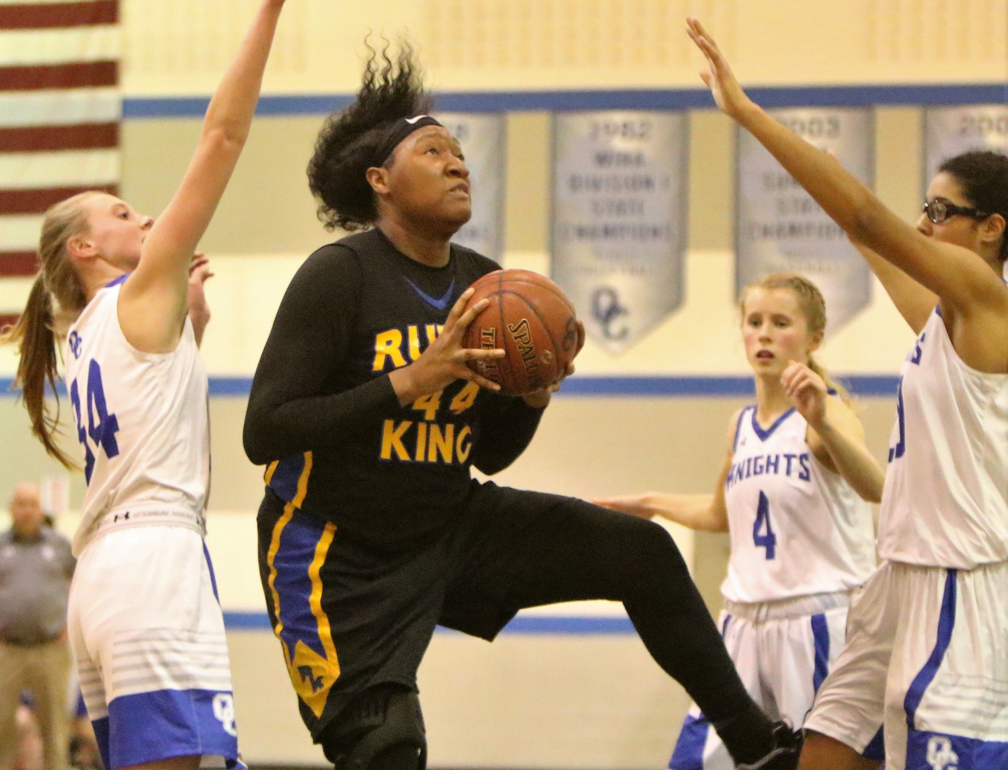 Milwaukee King center Sydnee Roby goes up for a shot near the rim against Oak Creek on December 4.