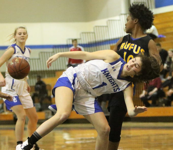 Oak Creek guard Valentina Shehu is fouled while going up for a rebound against Milwaukee King during a game on December 4.