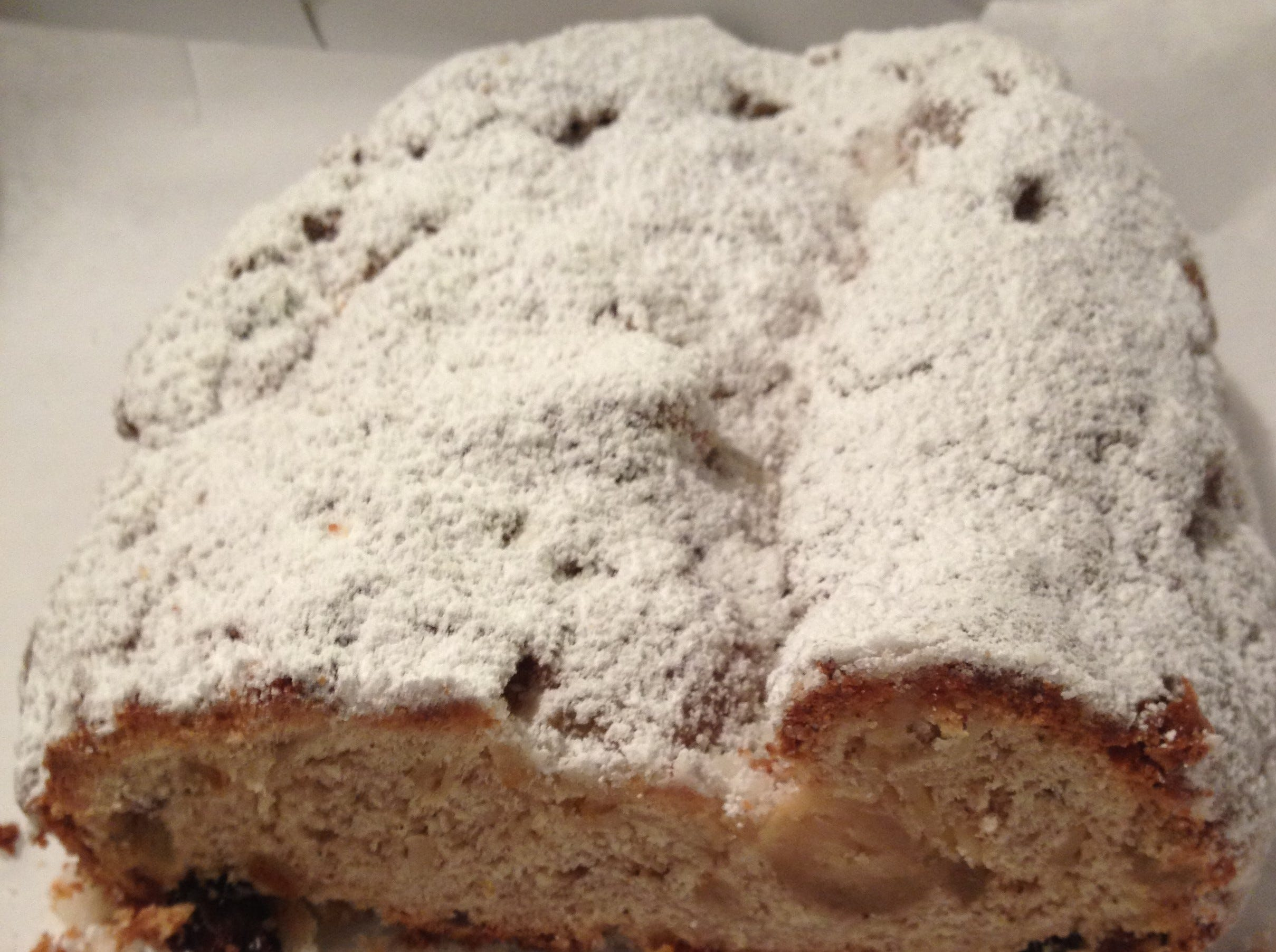 A traditional stollen is folded to resemble the swaddling of the baby Jesus. It often has a length of almond paste or marzipan running through the center.