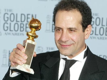 "Green Bay native Tony Shalhoub celebrates backstages after winning a Golden Globe for best actor in a comedy TV series for ""Monk"" on Jan. 19, 2003. Shalhoub is one of a dozen performers with Wisconsin ties to win the Golden Globe."