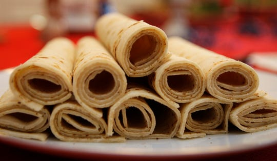 Lefse, a potato bread, is displayed as part of a traditional Scandinavian smorgasbord.