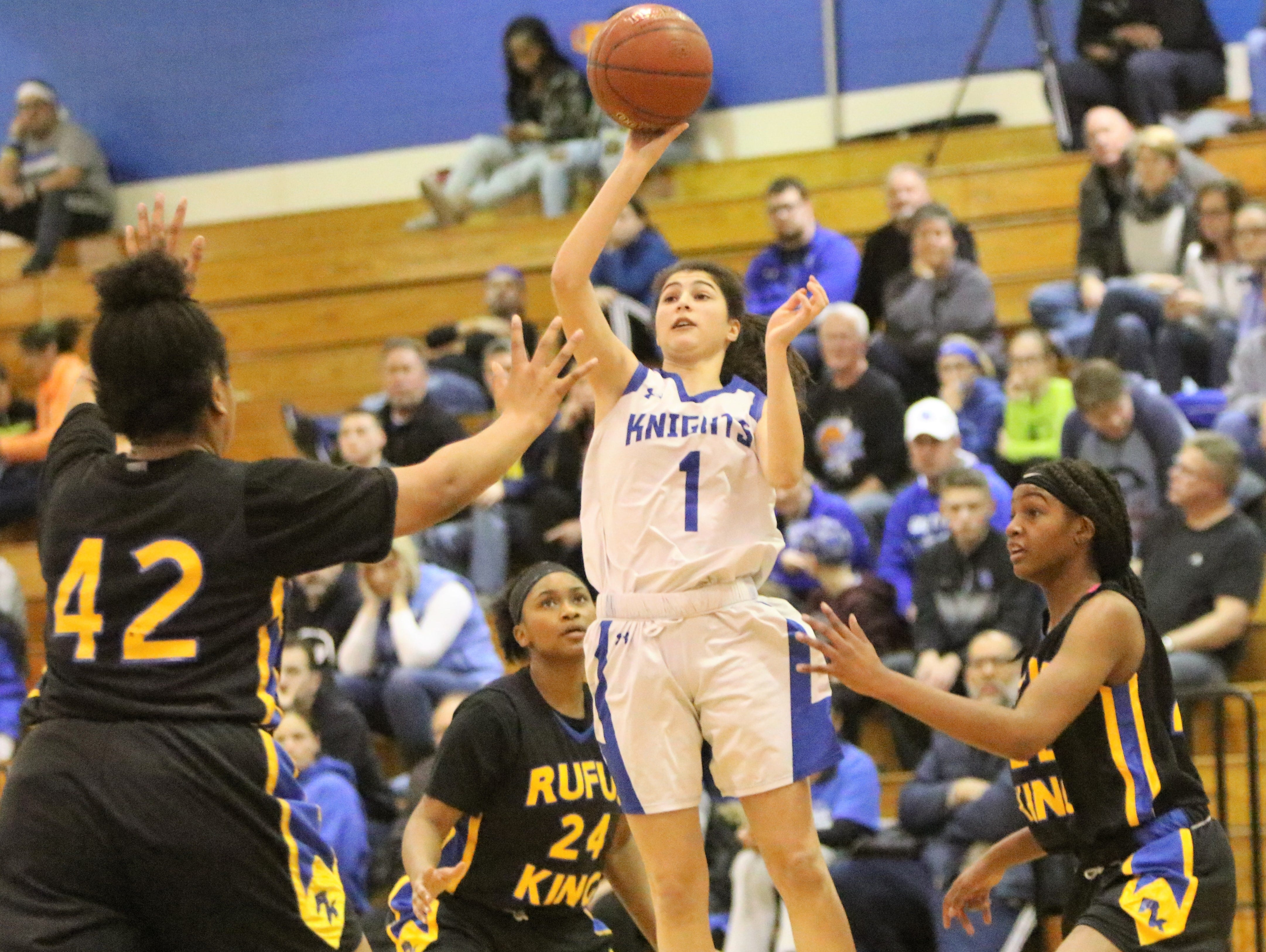 Oak Creek guard Valentina Shehu puts up a floater between a group of Milwaukee King defenders on December 4.