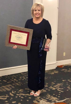 Baxter County Assessor Jayme Nicholson was recently selected as the state's Outstanding Assessor of the Year by the International Association of Assessing Officers.