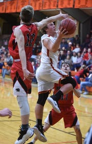 Viola's Clint Lester goes up for two past Norfork's Jaden McFall on Tuesday night.