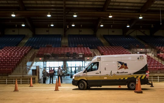 Acadian Ambulance Service's Neil Davis drives an ambulance to demonstrate the driving obstacle course during orientations held at the Ike Hamilton Convention Center in West Monroe, La. on Dec. 5.