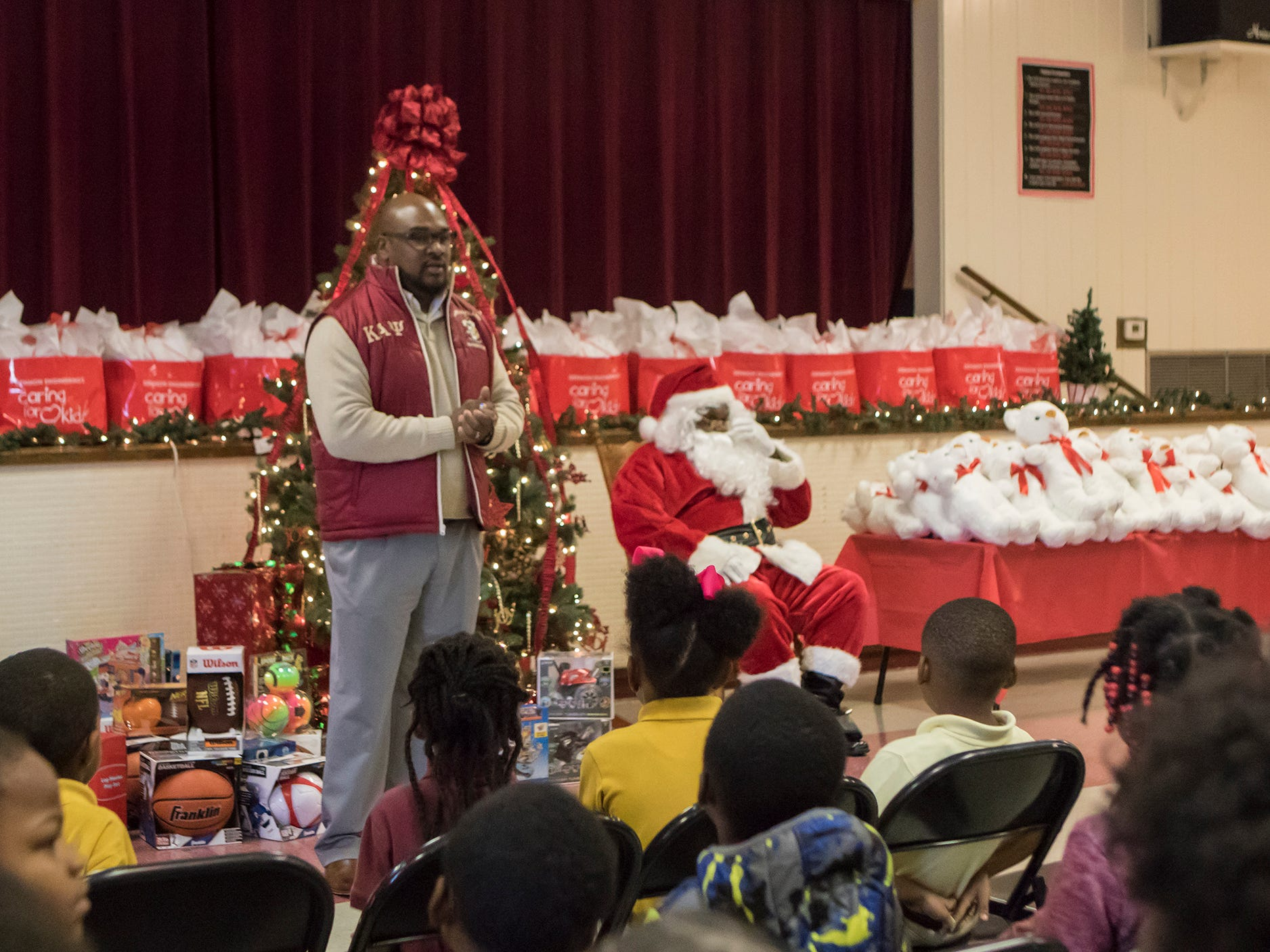 "Santa Claus visited students at Berg Jones Elementary School and handed out presents for the children in Monroe, La. on Dec. 5. The gifts were donated by Denmon Engineering as part of their annual ""Caring for Christmas"" drive."