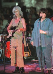 Emmy Lou Harris and Linda Ronstadt start off their performance at the Celebrity Theater in Phoenix in 1999.
