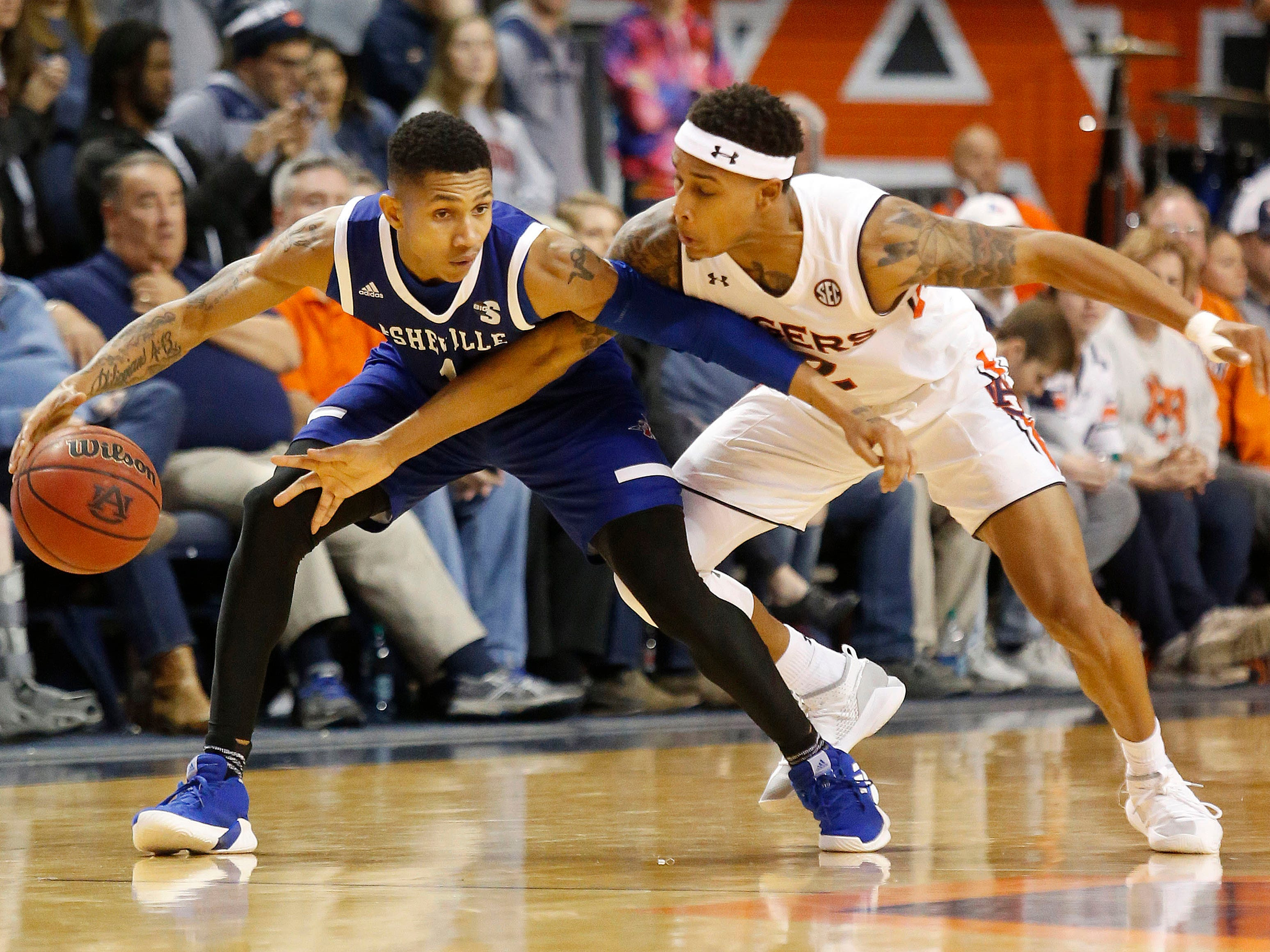 Auburn guard Bryce Brown (2) pressures UNC Asheville guard DeVon Baker (20) on Dec. 4, 2018, in Auburn, Ala.