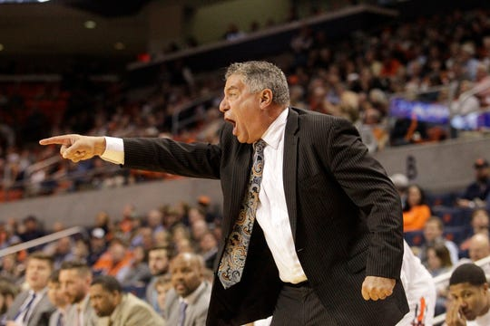 Auburn head coach Bruce Pearl yells to his team during the first half against the UNC Asheville at Auburn Arena.