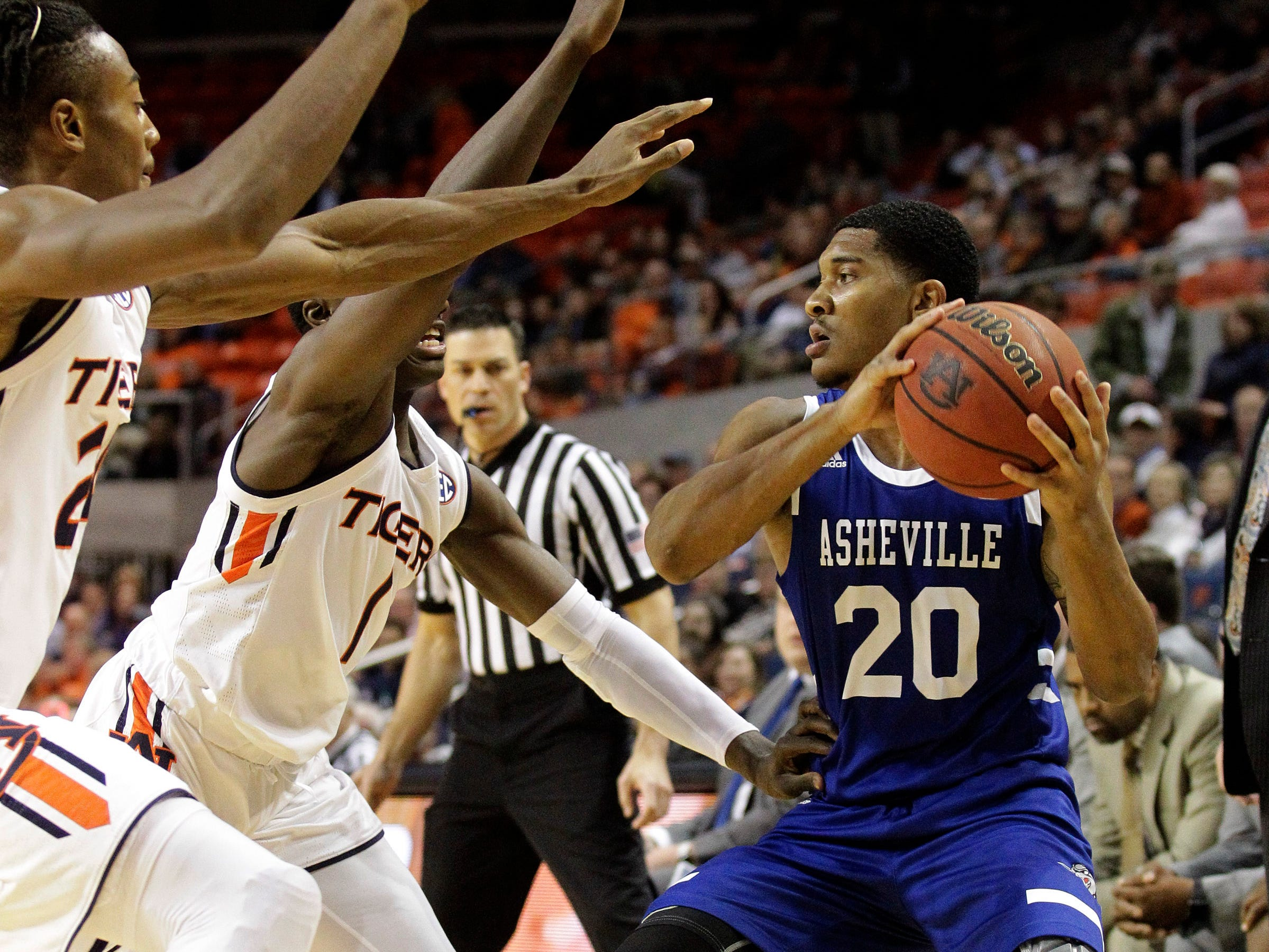 Dec 4, 2018; Auburn, AL, USA; Auburn Tigers forward Anfernee McLemore (left) and guard Jared Harper (middle) pressure UNC-Asheville Bulldogs guard DeVon Baker (20) during the first half at Auburn Arena. Mandatory Credit: John Reed-USA TODAY Sports