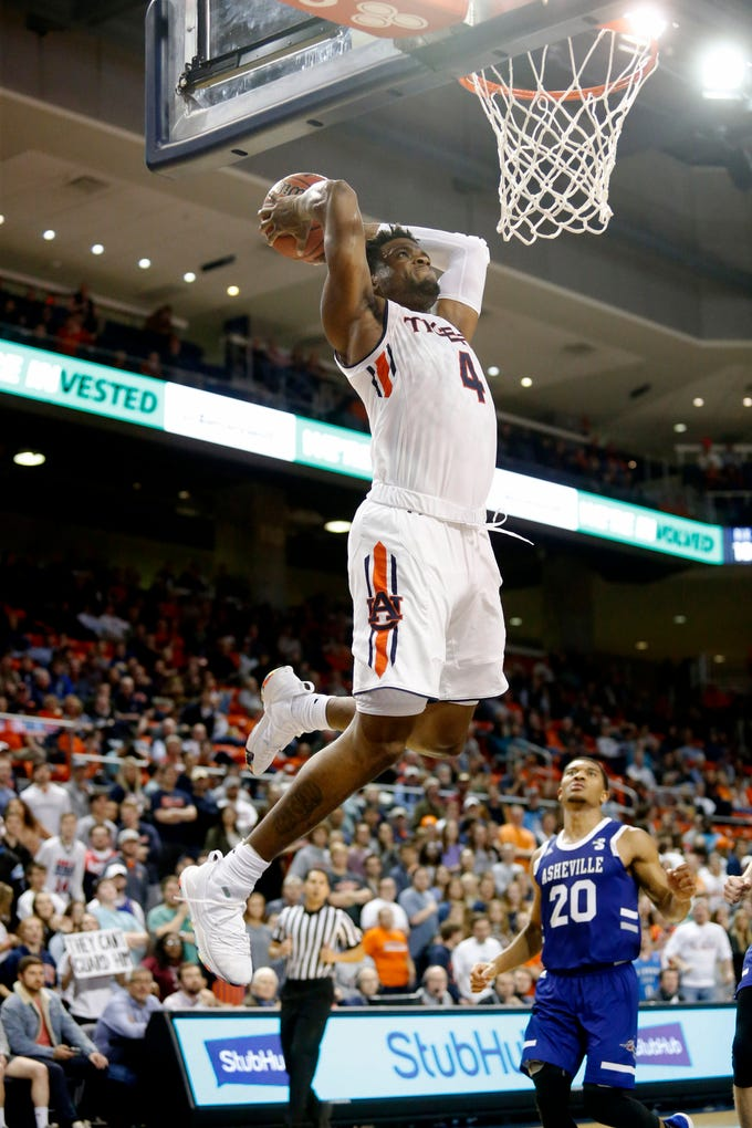 Dec 4, 2018; Auburn, AL, USA; Auburn Tigers forward Malik Dunbar (4) leaps for a dunk against the UNC-Asheville Bulldogs during the second half at Auburn Arena. Mandatory Credit: John Reed-USA TODAY Sports