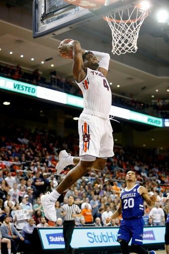Dec 4, 2018; Auburn, AL, USA; Auburn Tigers forward Malik Dunbar (4) leaps for a dunk against the UNC-Asheville Bulldogs during the second half at Auburn Arena. Mandatory Credit: John Reed-USA TODAY Sports