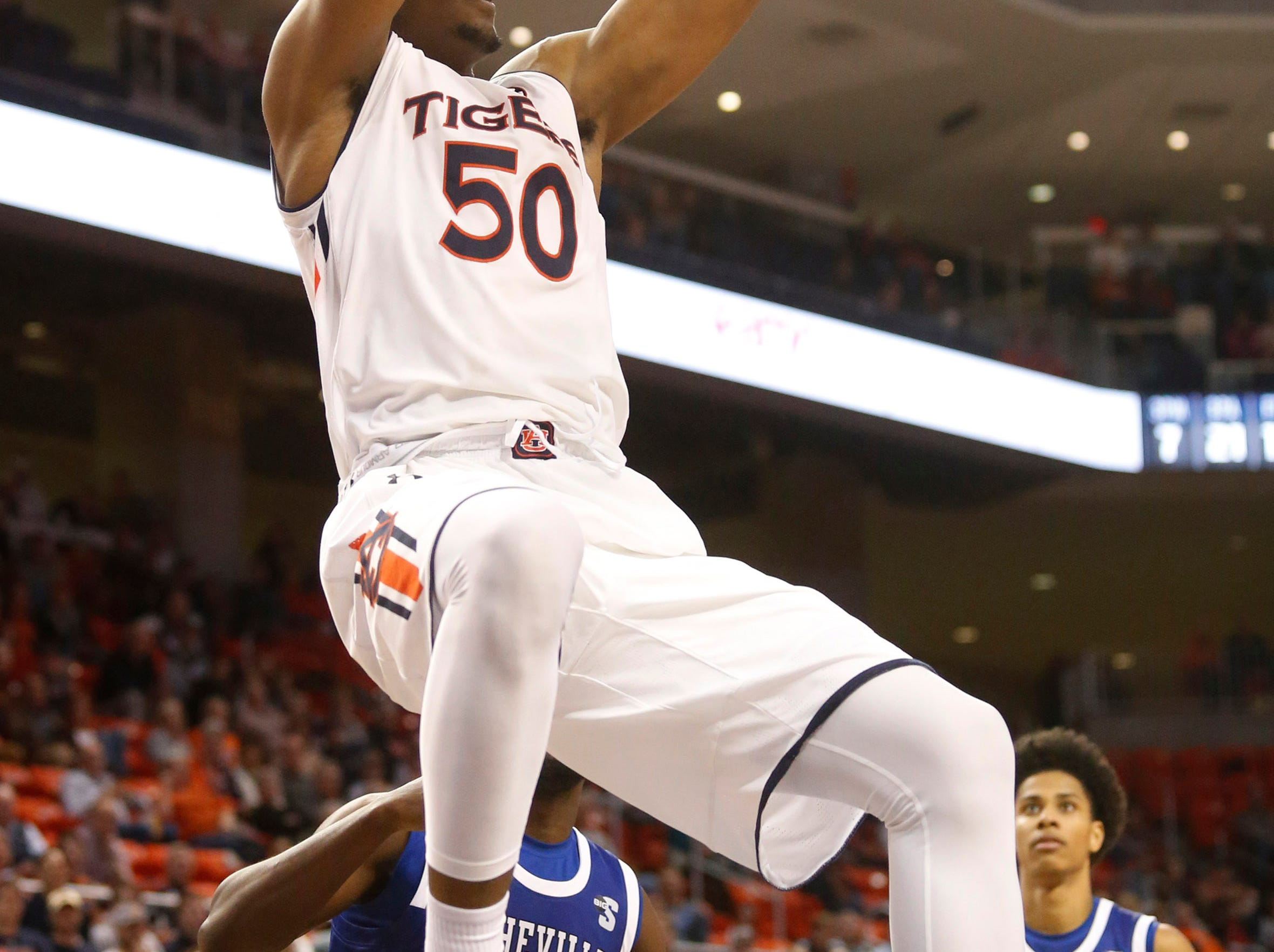 Dec 4, 2018; Auburn, AL, USA; Auburn Tigers center Austin Wiley (50) makes a dunk against the UNC-Asheville Bulldogs during the second half at Auburn Arena. Mandatory Credit: John Reed-USA TODAY Sports