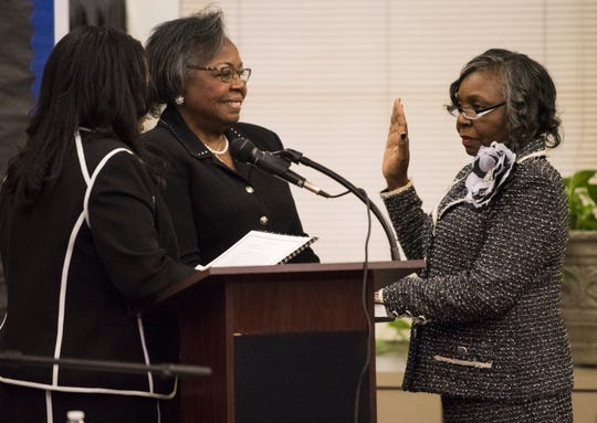 Brenda DeRamus-Coleman, right, is sworn in as a board member during the MPS school board meeting in Montgomery, Ala., on Tuesday, Dec. 4, 2018.