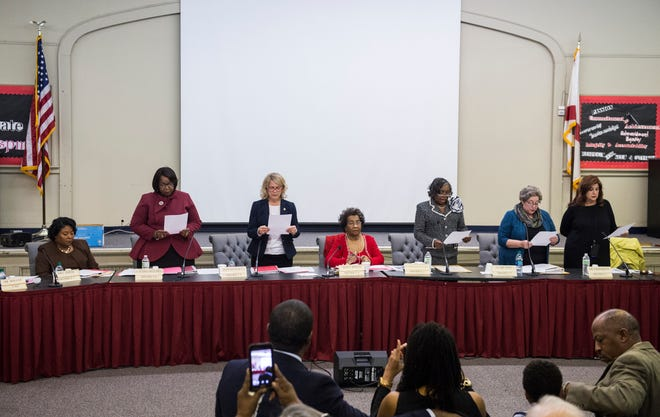 Newly-elected members recite a promise during the MPS school board meeting in Montgomery, Ala., on Tuesday, Dec. 4, 2018.