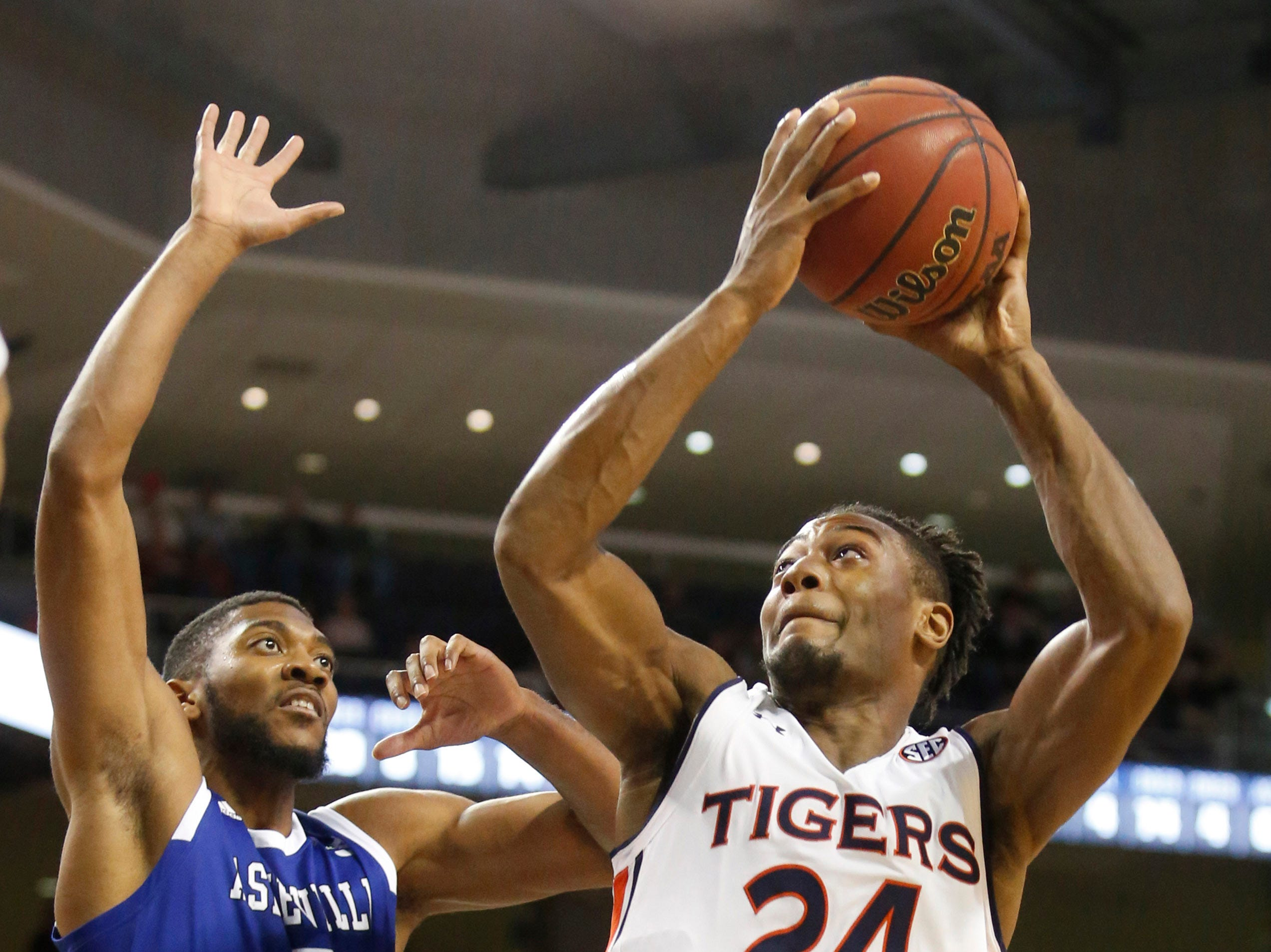 Dec 4, 2018; Auburn, AL, USA; Auburn Tigers forward Anfernee McLemore (24) takes a shot against UNC-Asheville Bulldogs forward Donovan Gilmore (0) during the second half at Auburn Arena. Mandatory Credit: John Reed-USA TODAY Sports