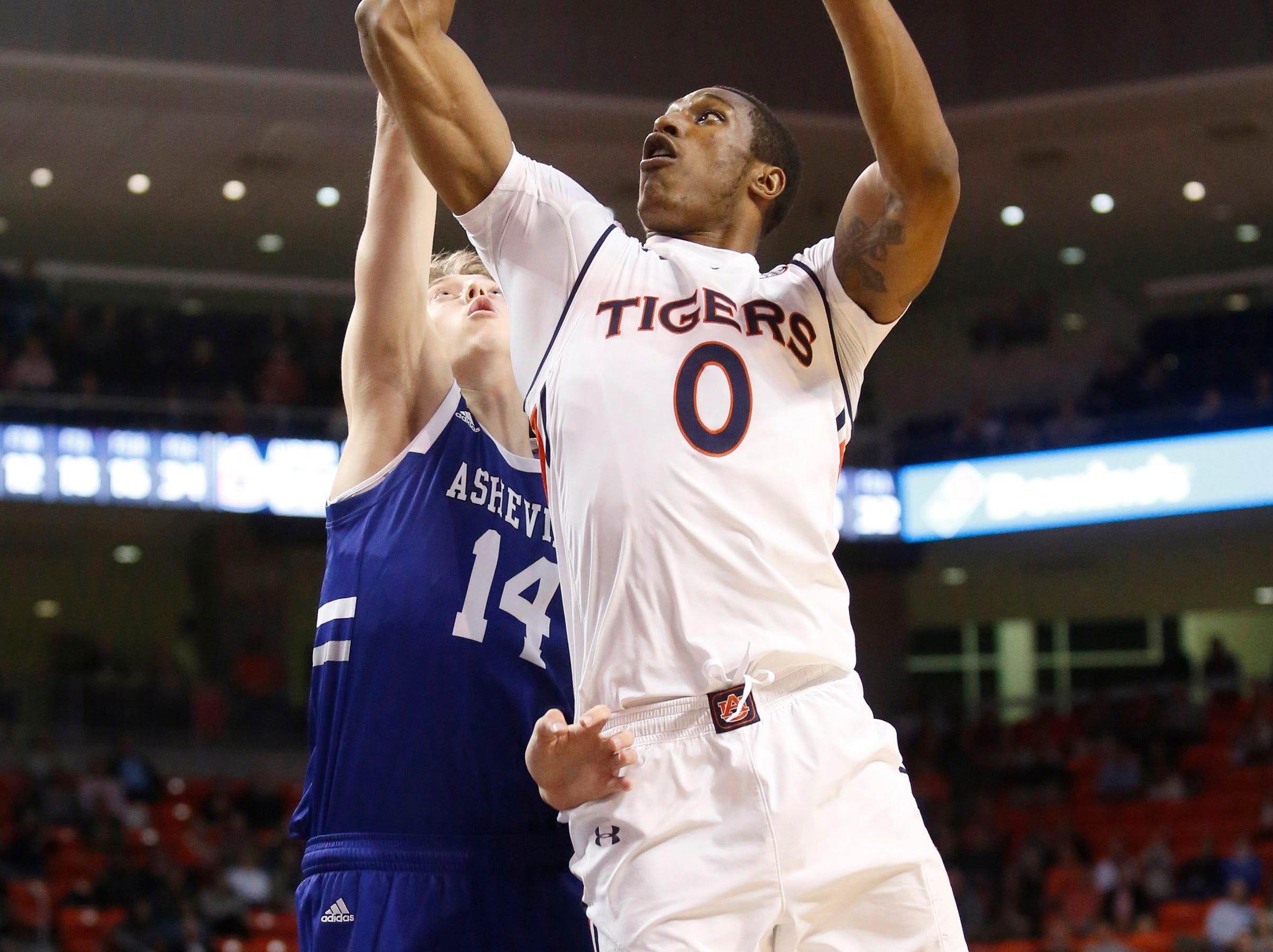 Dec 4, 2018; Auburn, AL, USA; Auburn Tigers forward Horace Spencer (0) shoots over UNC-Asheville Bulldogs forward Luke Lawson (14) during the second half at Auburn Arena. Mandatory Credit: John Reed-USA TODAY Sports