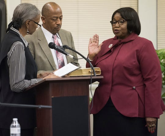 Claudia Mitchell, right, is sworn in as a board member during the MPS school board meeting in Montgomery, Ala., on Tuesday, Dec. 4, 2018.