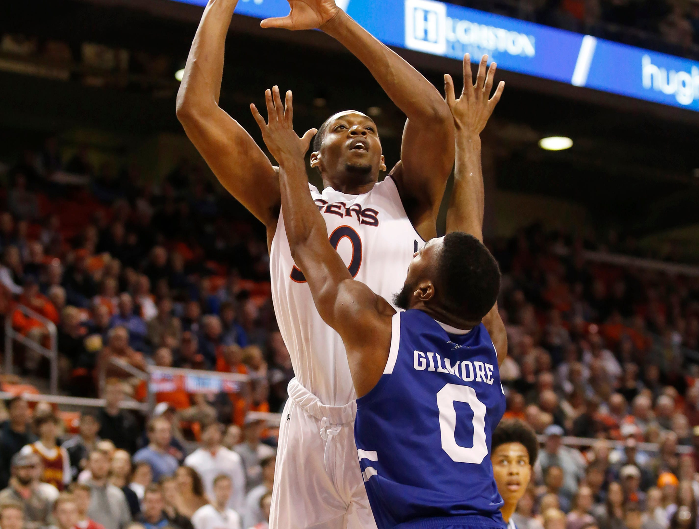 Dec 4, 2018; Auburn, AL, USA; Auburn Tigers center Austin Wiley (50) shoots over UNC-Asheville Bulldogs forward Donovan Gilmore (0) during the second half at Auburn Arena. Mandatory Credit: John Reed-USA TODAY Sports