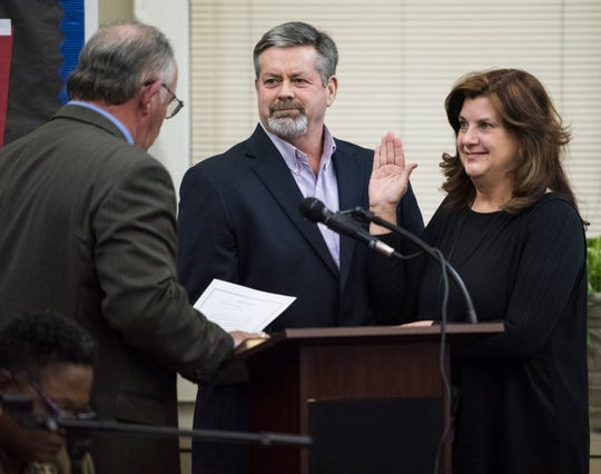 Lesa Keith, right, is sworn in as a board member during the MPS school board meeting in Montgomery, Ala., on Tuesday, Dec. 4, 2018.
