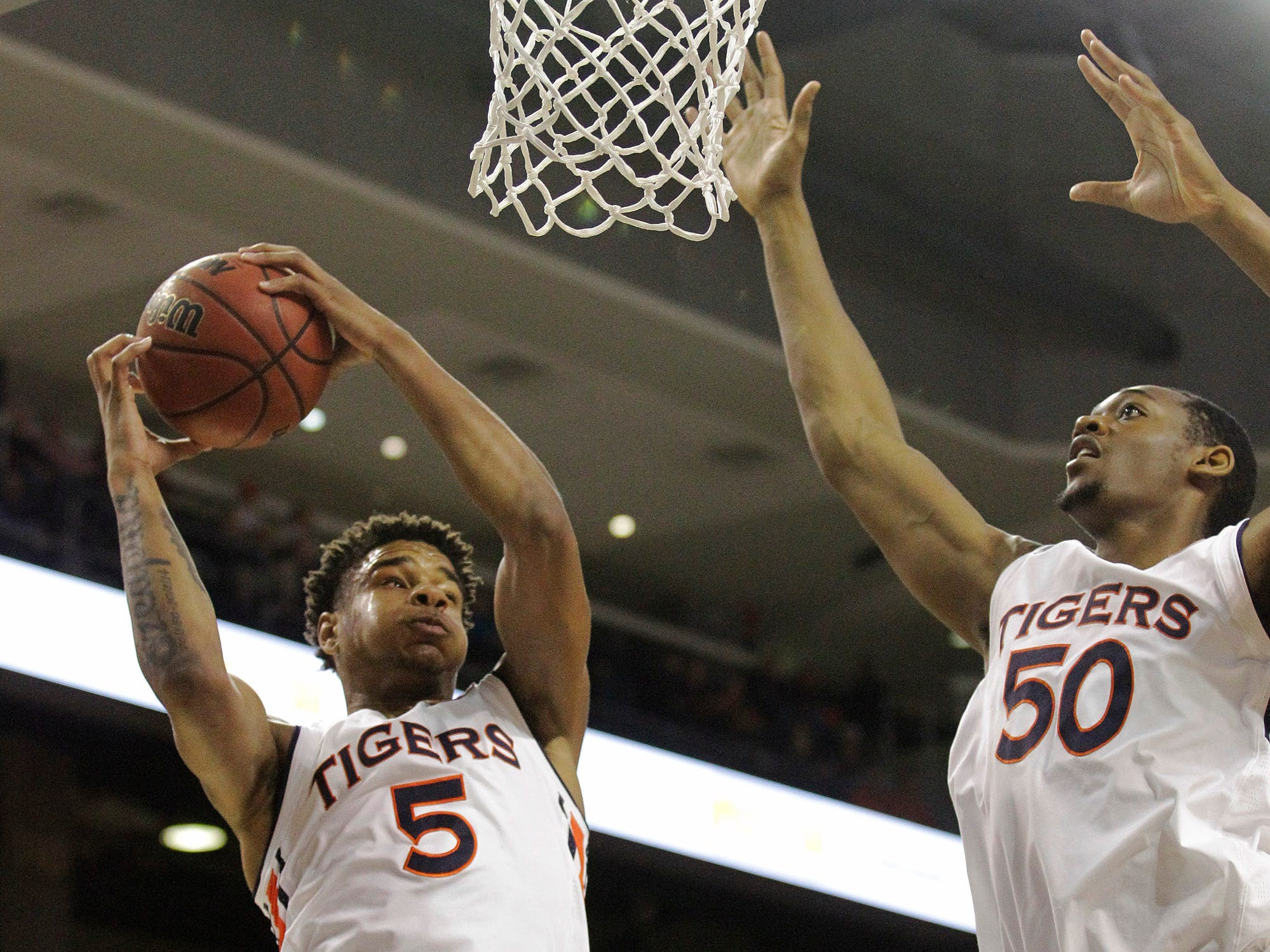 Dec 4, 2018; Auburn, AL, USA; Auburn Tigers forward Chuma Okeke (5) grabs a rebound from center Austin Wiley (50) during the first half against the UNC-Asheville Bulldogs at Auburn Arena. Mandatory Credit: John Reed-USA TODAY Sports