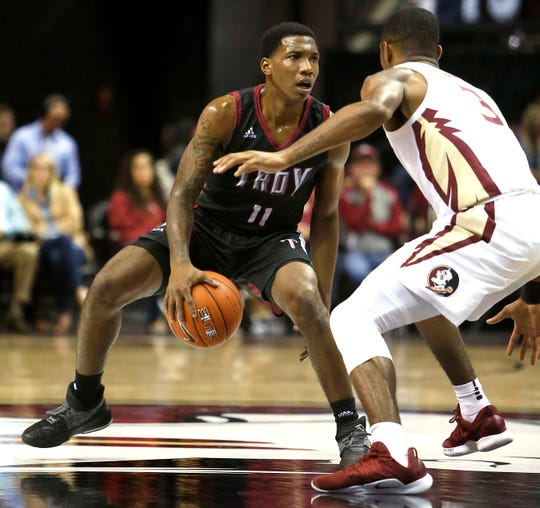 Dec 3, 2018; Tallahassee, FL, USA; Troy Trojans guard B.J. Miller (11) looks for an opening abasing Florida State Seminoles guard Trent Forrest (3) at Donald L. Tucker Center during the second half. Mandatory Credit: Glenn Beil-USA TODAY Sports