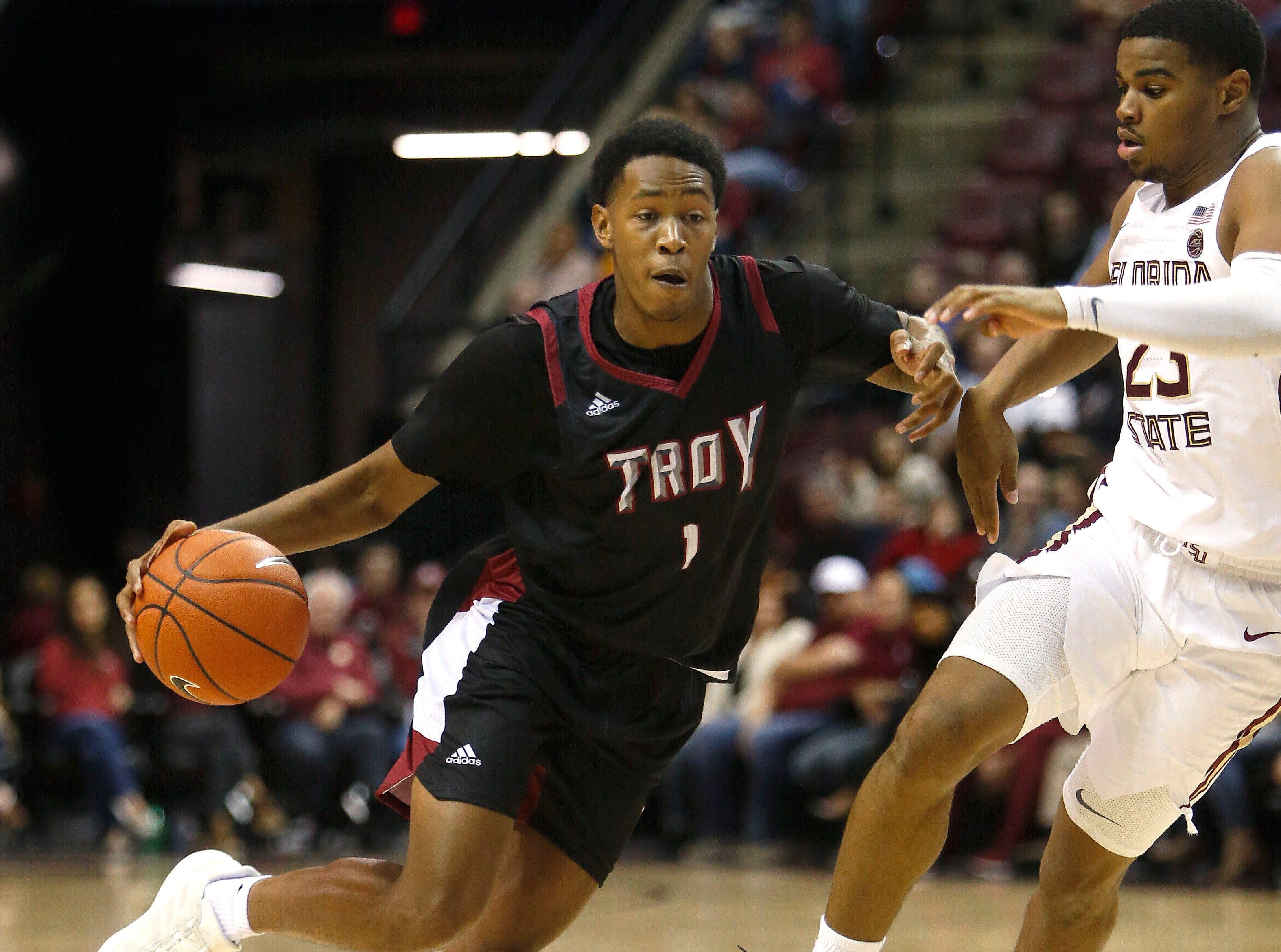 Dec 3, 2018; Tallahassee, FL, USA; Troy Trojans forward Javan Johnson (1) drives abasing Florida State Seminoles guard M.J. Walker (23) at Donald L. Tucker Center during the second half. Mandatory Credit: Glenn Beil-USA TODAY Sports