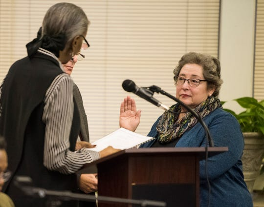 Clare Weil, right, is sworn in as a board member during the MPS school board meeting in Montgomery, Ala., on Tuesday, Dec. 4, 2018.
