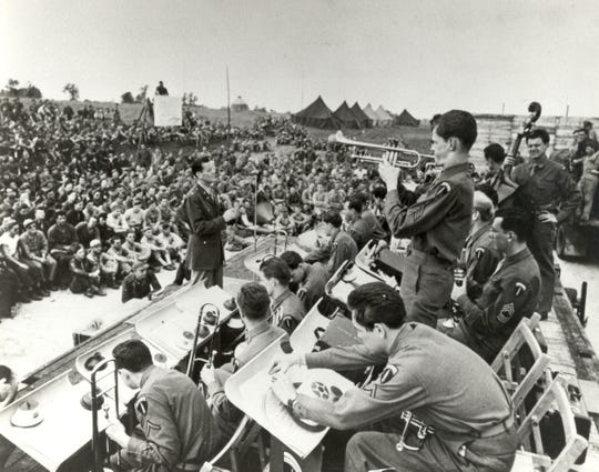 Major Glenn Miller directing his band at one of 300 live performances in England from mid-June to mid-December 1944. On Dec. 15, 1944, Miller boarded a plane bound for recently liberated Paris. Tragically, the aircraft disappeared over the English Channel on its way to Paris, and Miller is still listed as missing in action.