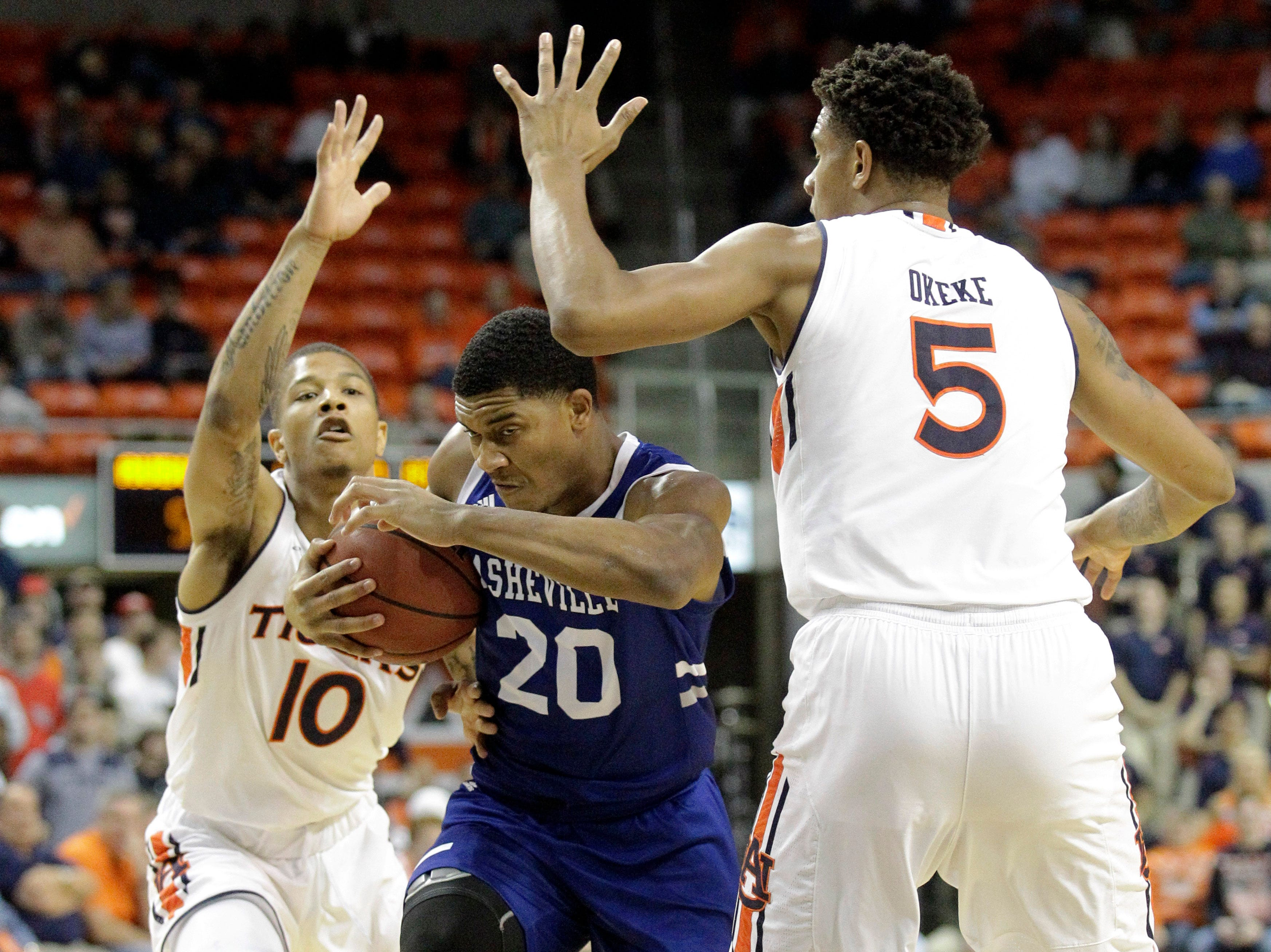 Dec 4, 2018; Auburn, AL, USA; Auburn Tigers guard Samir Doughty (10) and forward Chuma Okeke (5) pressure UNC-Asheville Bulldogs guard DeVon Baker (20) during the first half at Auburn Arena. Mandatory Credit: John Reed-USA TODAY Sports