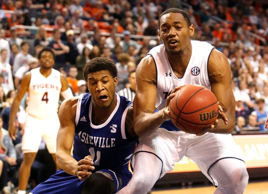 Auburn center Austin Wiley (50) is fouled by UNC Asheville guard Jalen Seegars (11) during the second half at Auburn Arena on Dec. 4, 2018.