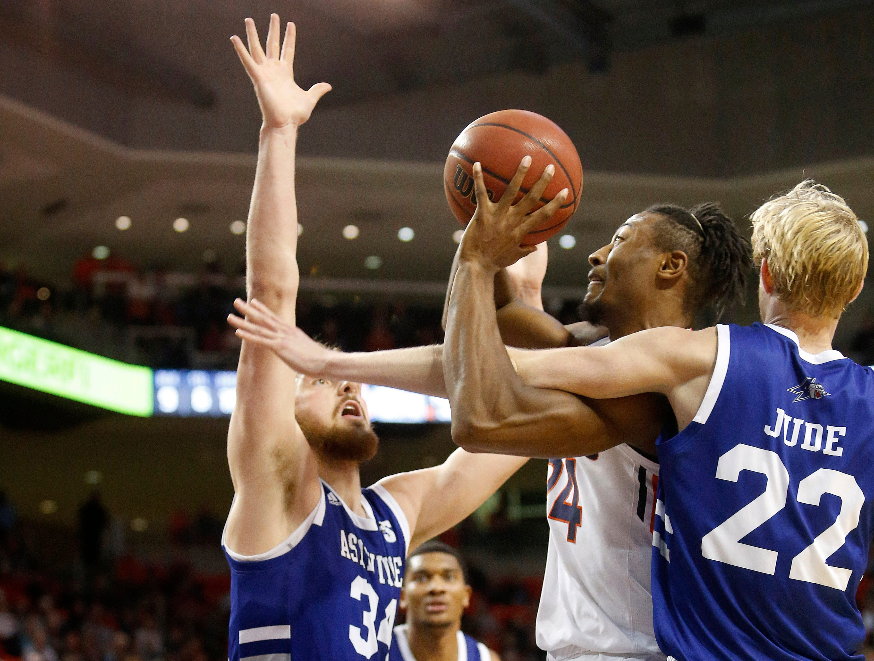 Dec 4, 2018; Auburn, AL, USA; Auburn Tigers forward Anfernee McLemore (24) is fouled by UNC-Asheville Bulldogs forward Coty Jude (22) during the second half at Auburn Arena. Mandatory Credit: John Reed-USA TODAY Sports