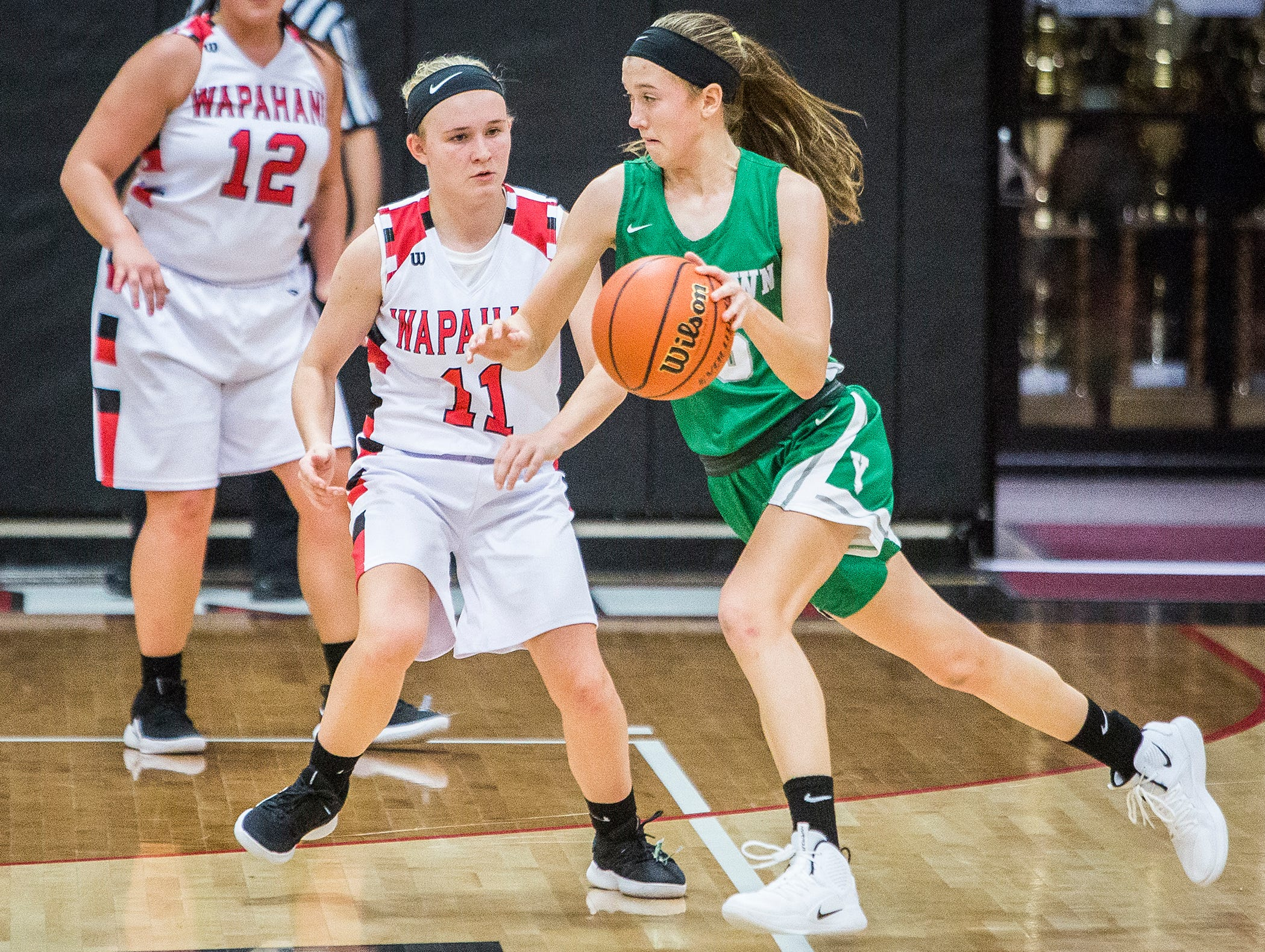 Yorktown's Lea Alexander dribbles the ball against Wapahani during their game at Wapahani High School Tuesday, Dec. 4, 2018.